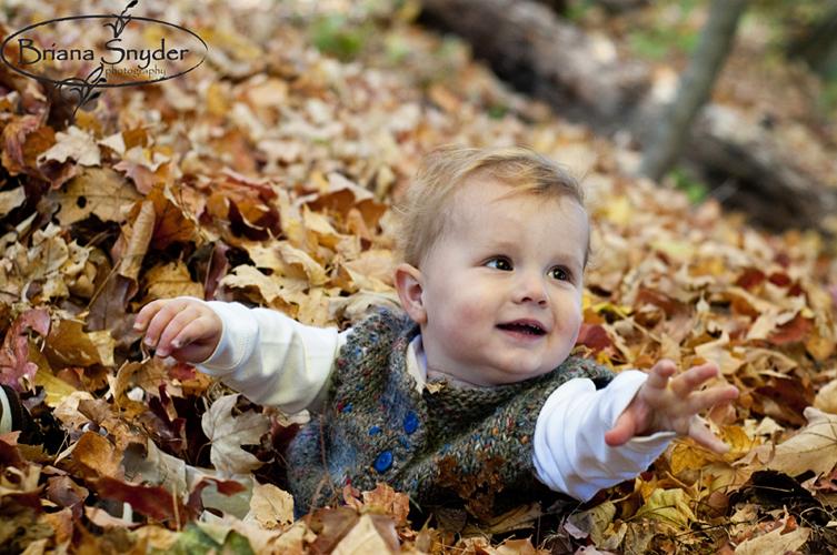 cute baby in leaves