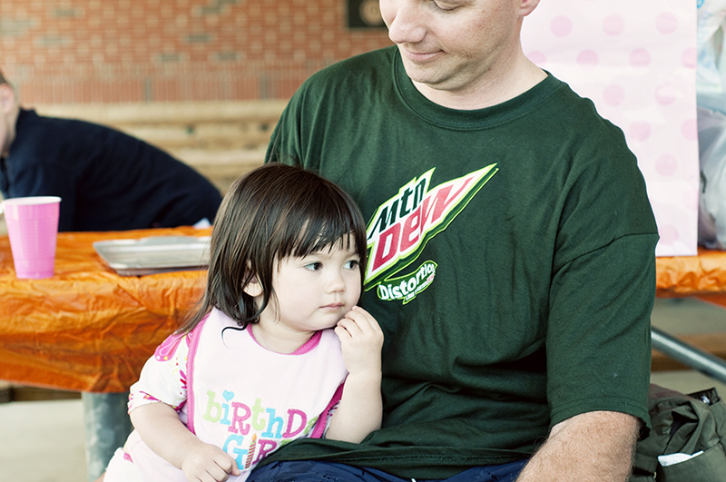 two year old girl sitting with her dad