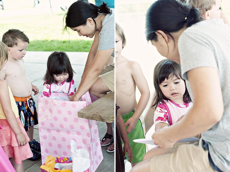 little girl getting birthday presents