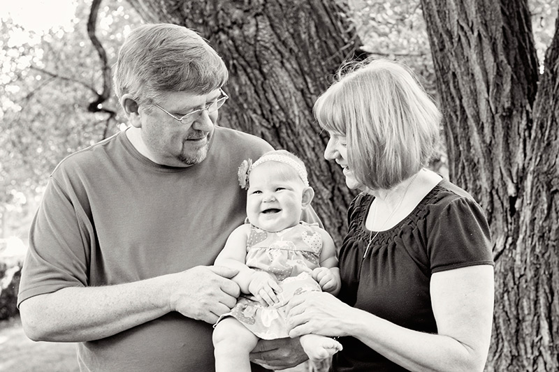 baby laughing with her grandparents