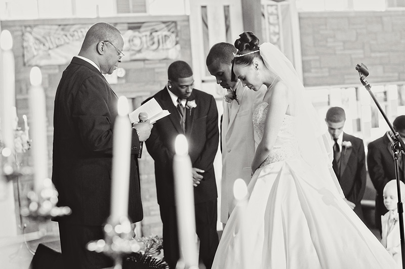 couple praying during their wedding