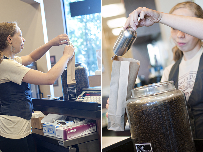 barista bagging coffee beans