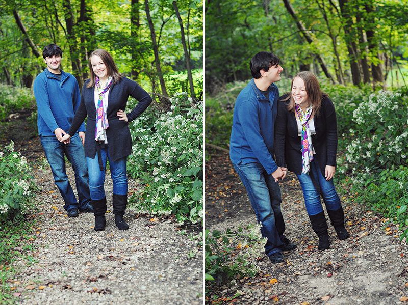 couple walking in the woods and laughing