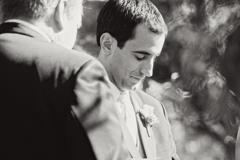 groom praying during ceremony