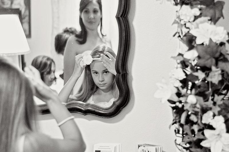 flower girl getting ready before wedding