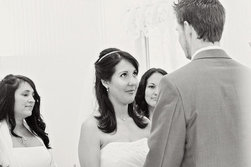 bride looking at groom during the wedding ceremony