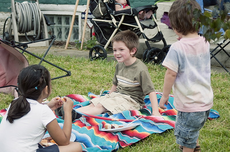 children laughing at a garden party