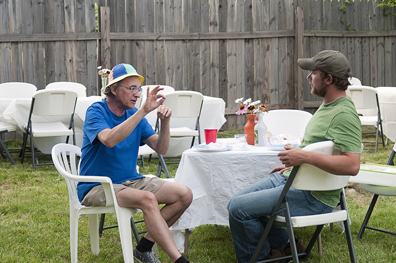 neighbors talking at a party