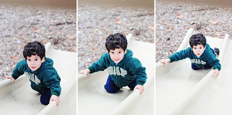 little boy climbing up a slide
